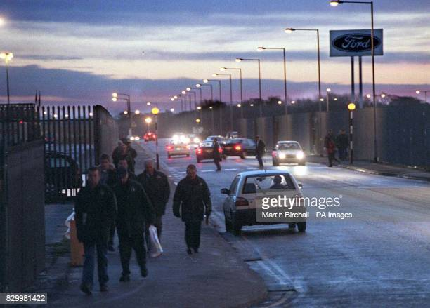 Early morning shift workers arrive at the Ford Halewood plant in Merseyside today to await the announcement of the mini Jaguar car production later...