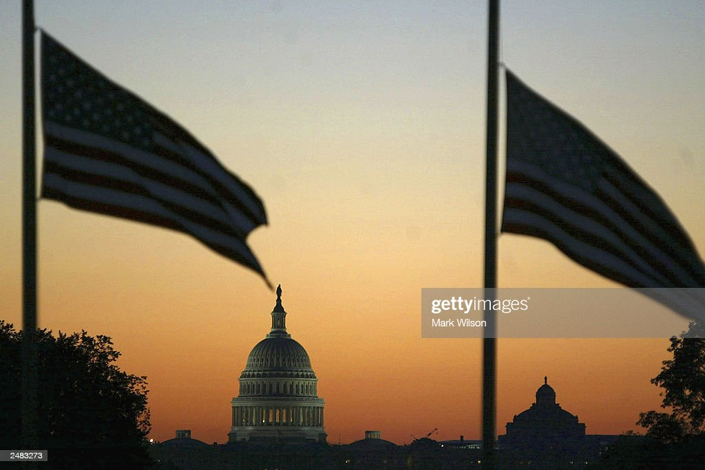 Early morning sun rises over the US Capitol as flags are at half staff on the Washington Monument grounds September 11, 2003 in Washington, DC. Today marks the second anniversary to the terrorist attacks at the World trade Center and the Pentagon.