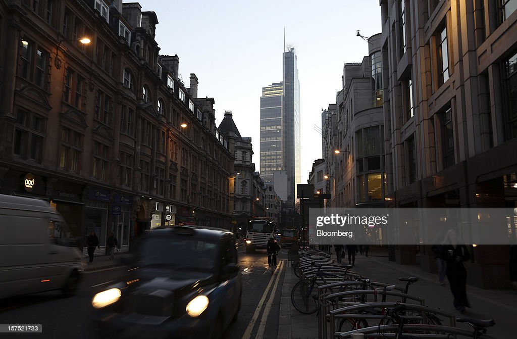 Early morning traffic passes along a road in front of the of The Heron Tower, centre, in London, U.K., on Friday, Nov. 30, 2012. U.K. banks have become more unwilling to finance development projects without a tenant committed to lease space or a buyer for the completed property. Photographer: Chris Ratcliffe/Bloomberg via Getty Images