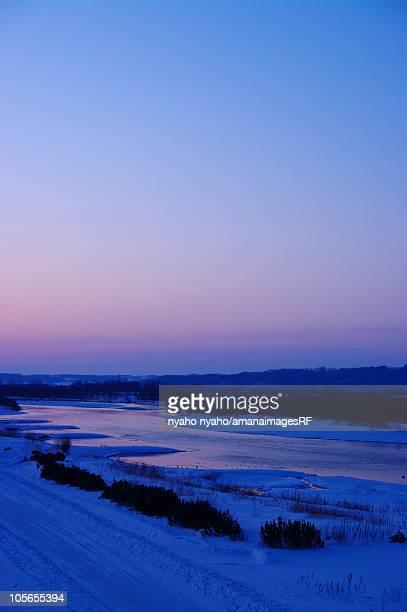 Early Morning Twilight Over the Tokachi River. Hokkaido, Japan