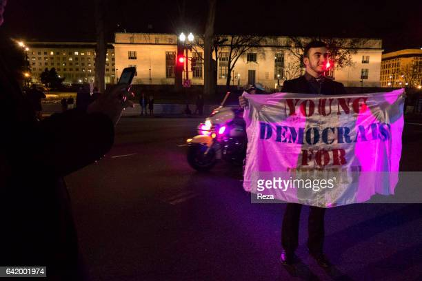 Early on Donald Trump's inauguration day on January 20th a young man wears a banner saying 'Young democrats for Trump' Donald Trump the 45th...