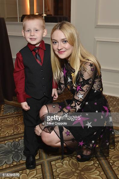 Early Steps Program participants Brantly Smith and actress and Save the Children Artist Ambassador Dakota Fanning attend the 4th Annual Save the...