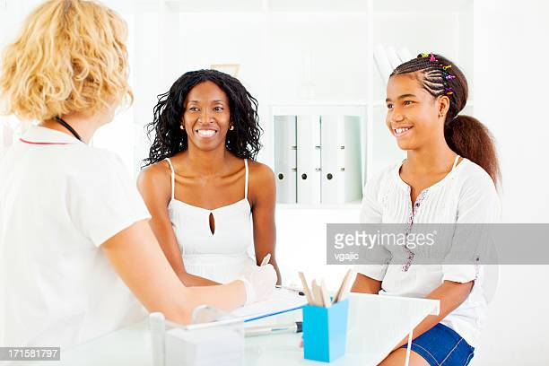 Early Teenage Girl with mother Visit Doctor