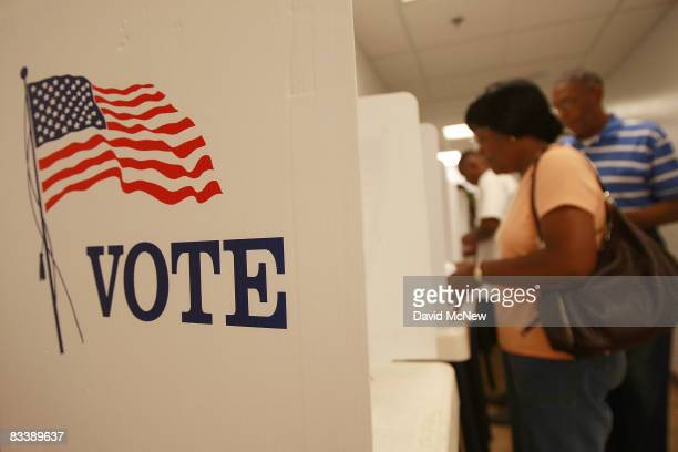 Early voters cast their ballots at the Los Angeles County Registrar of Voters office on October 22 2008 in Norwalk California With less than two...