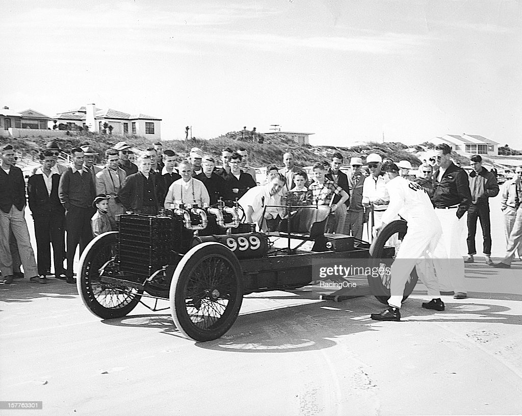 "Crewmembers work on the famous ""999"" of Barney Oldfield before a speed run on Daytona Beach Oldfield when originally hired by Henry Ford to drive the..."