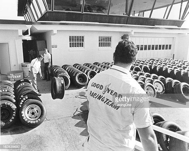 Workers get Goodyear racing tires ready for action just outside the Goodyear Tower in the pit area of Daytona International Speedway prior to a...
