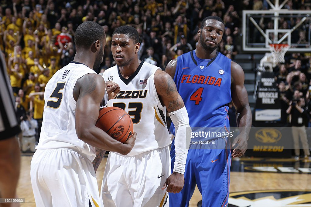 Earnest Ross #33 and Keion Bell #5 of the Missouri Tigers celebrate in the closing seconds of the game against the Florida Gators at Mizzou Arena on February 19, 2013 in Columbia, Missouri. Missouri upset Florida 63-60.
