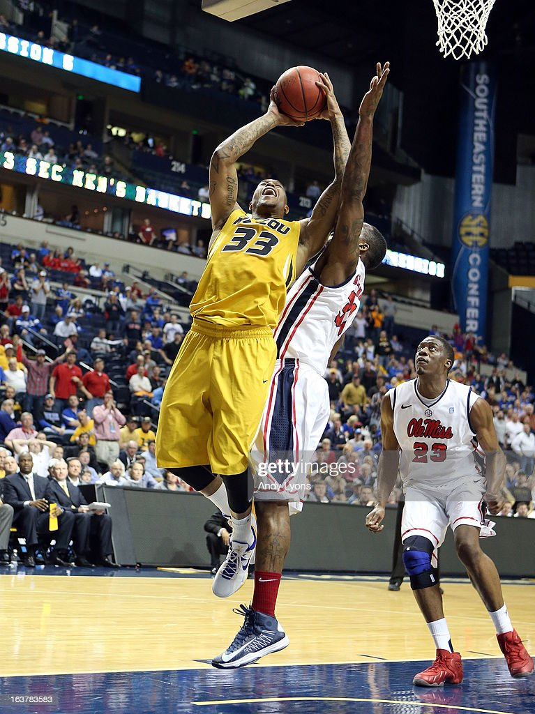 Earnest Ross #33 of the Missouri Tigers shoots the ball against the Ole Miss Rebels during the quarterfinals of the SEC Baketball Tournament at Bridgestone Arena on March 15, 2013 in Nashville, Tennessee.