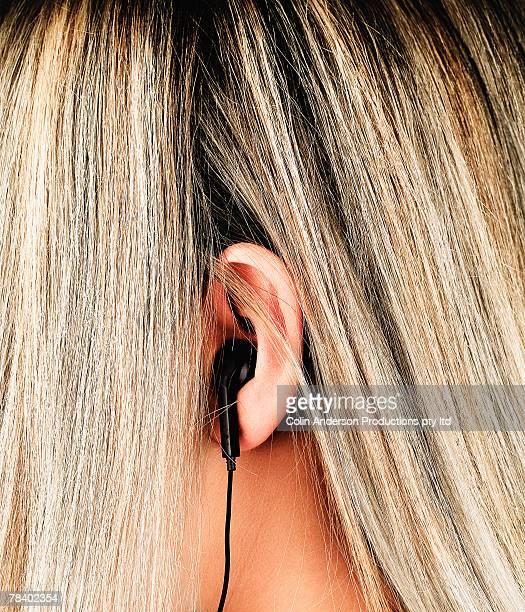 Earpiece in ear of woman