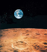 Earth and lunar surface with star background