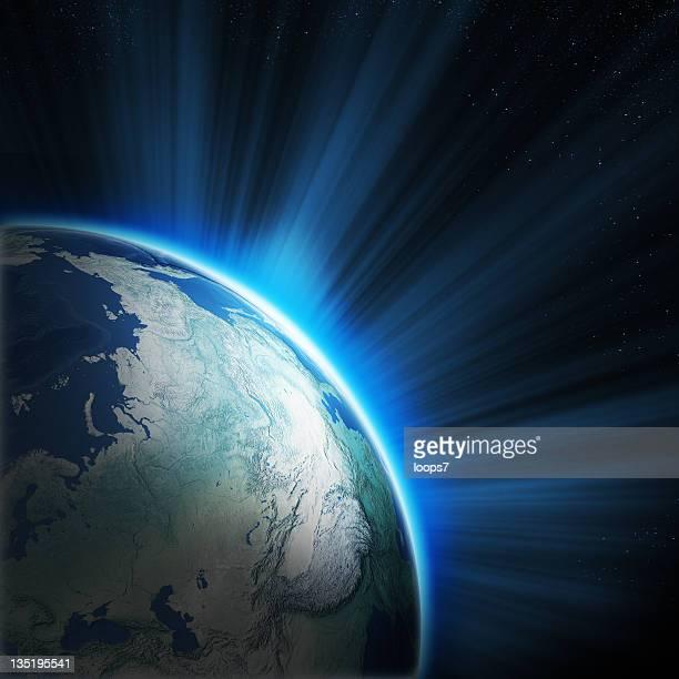 Erde und der aufgehenden Sonne