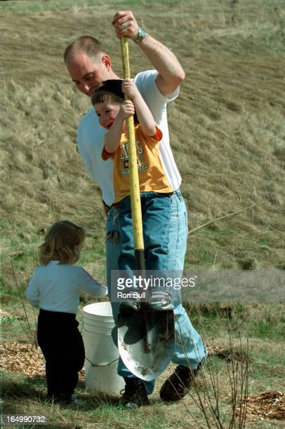 Earth Day 04/22/01 Earth Day atDownsview park sheppard and keele St several hundred children adults and scouts plant trees to celebrate Earth Day I...