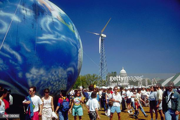 Earth Day Crowds With Inflatable Globe and Windmill