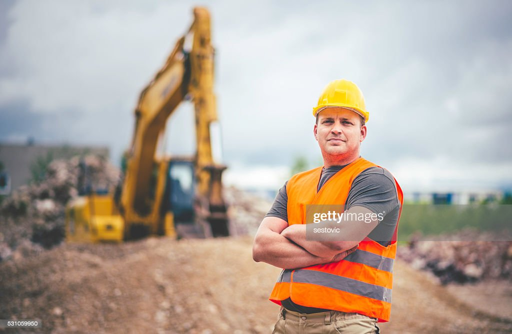 Earth Digger Driver at construction site : Stock Photo
