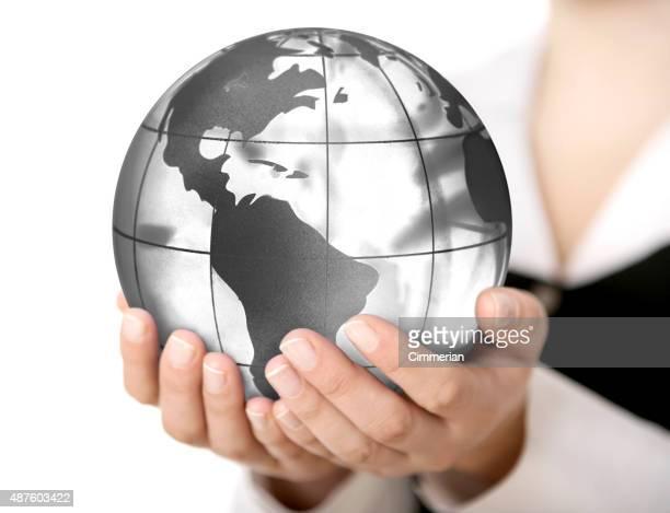 Earth globe (America view) in hands