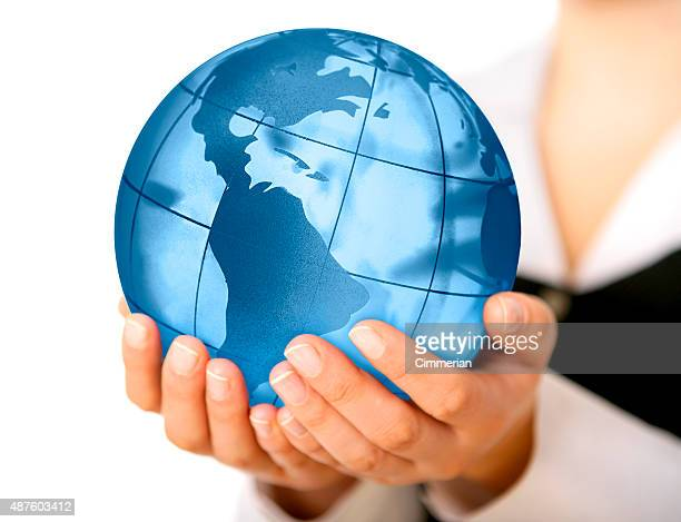 Earth globe (America view) in woman's hands