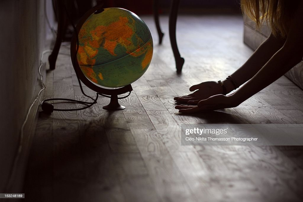Earth globe with hands : Stock Photo