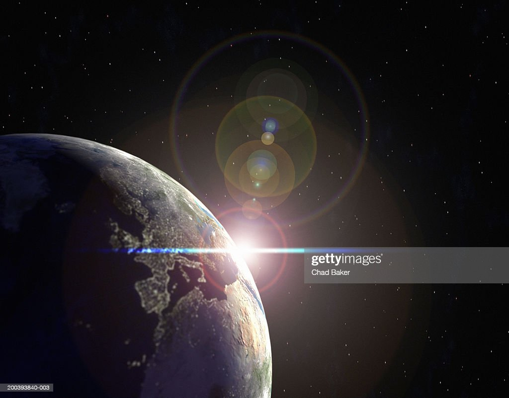 Earth in partial sunlight with city lights : Stock Photo