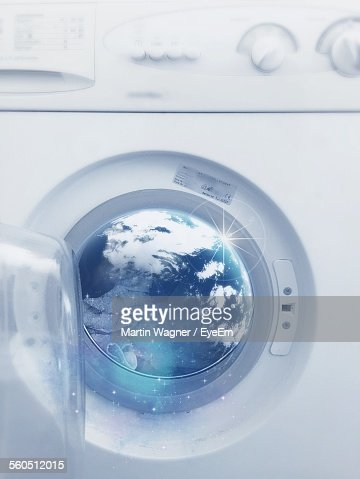 Earth On Glass Of Washing Machine