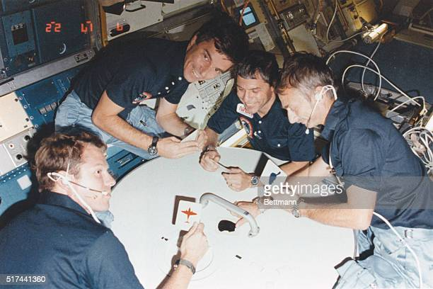 What appears to be a space card game is actually just four STS9 crew enjoying a rare brief moment of collective fun inside the Spacelab module on...