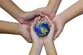 Earth planet in asian Children hand isolated on white - Elements of this image furnished by NASA