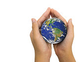 Earth planet in female hand isolated on white background - Elements of this image furnished by NASA