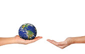 Earth planet the hand isolated on white background - Corporate social responsibility concept. - Elements of this image furnished by NASA