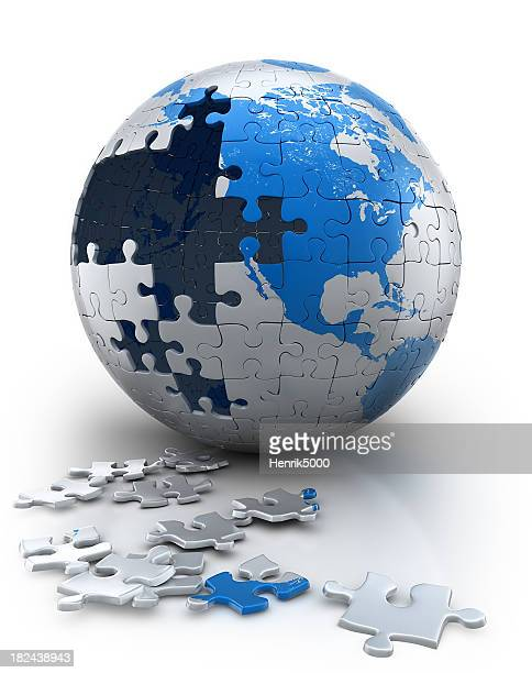 Earth puzzle in progress, focus on the USA (Clipping path)