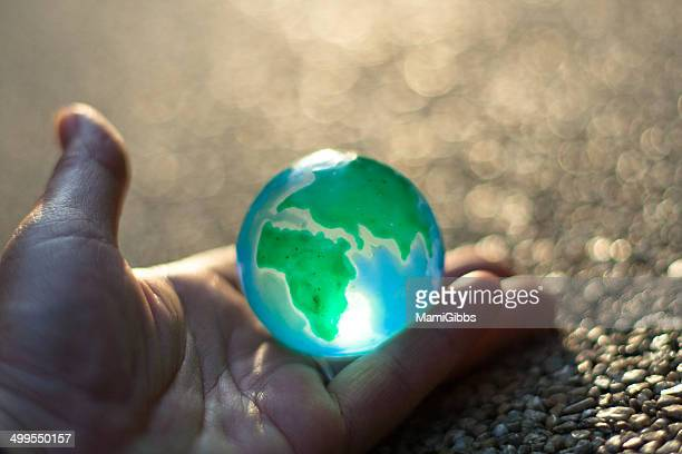 Earth toy on the hand