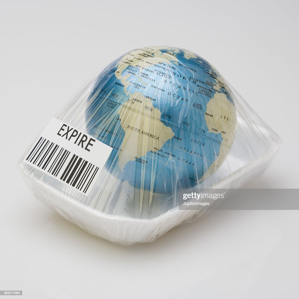 Earth wrapped with cellophane : Stock Photo