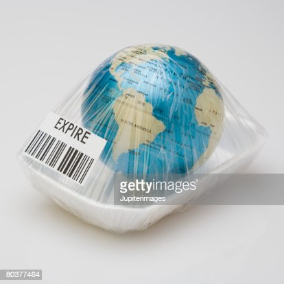 Earth wrapped with cellophane