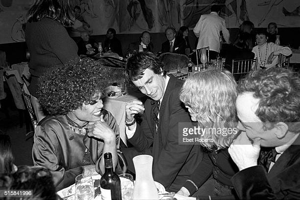 Eartha Kitt with actors Daniel DayLewis and Mia Farrow at the Cafe Carlyle in New York City on January 26 1994