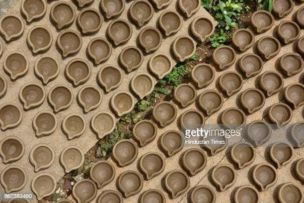 Earthen lamps kept for sun dry at Pottery Town on October 12 2017 in Bengaluru India Pottery Town is a patch of clay amid the City of Garden It's...