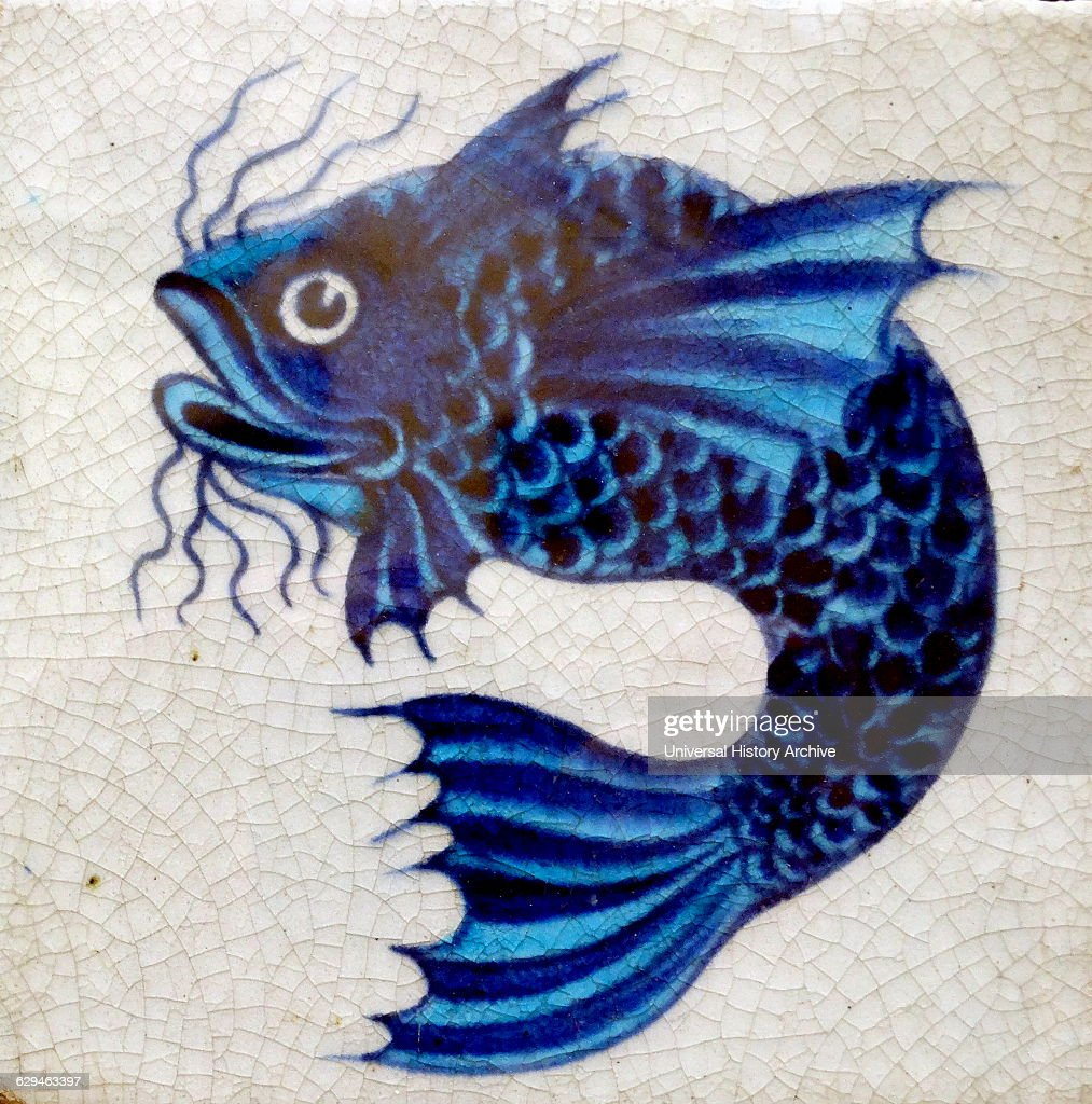 Earthernware tile with fish pattern with underglaze blue and lusters on a white slip Dated 1882