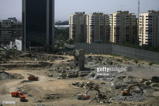 Earthmovers tear out a section of the city to make a new sports stadium August 9 2006 in Almaty in the central Asian country of Kazakhstan Fifteen...