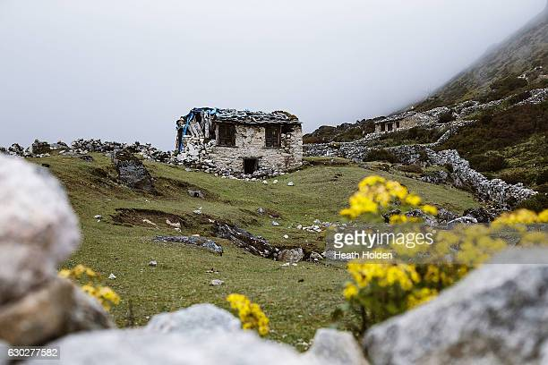 Earthquake damaged stone cabins line the trail into Machhermo on September 26 2016 in Machhermo Nepal The trails in the SoluKhumbu region of Nepal...