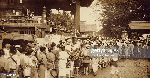 Earthquake survivors queue for aid supply at Sensoji Temple where the buildings managed to avoid the fire after the Great Kanto Earthquake in...