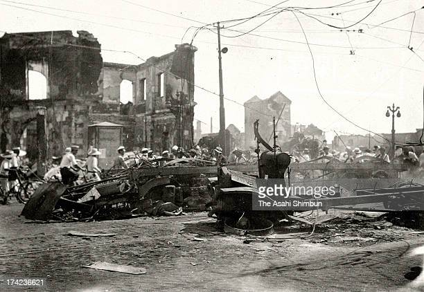 Earthquake survivors walk destroyed Ginza area after the Great Kando Earthquake in September 1923 in Tokyo Japan The estimated Magnitude 79 strong...
