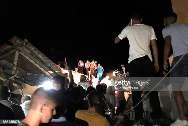 TOPSHOT Earthquake victims are rescued in the popular Italian tourist island of Ischia off the coast of Naples on August 21 2017 A 36 magnitude...
