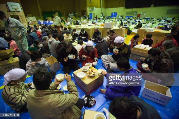 Earthquake victims gather for dinner at evacuation center on March 24 2011 in Kamaishi Iwate Prefecture Japan The 90 magnitude strong earthquake...