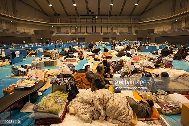 Earthquake victims gather inside evacuation center on March 27 2011 in Kesennuma Miyagi Prefecture Japan The 90 magnitude strong earthquake struck...