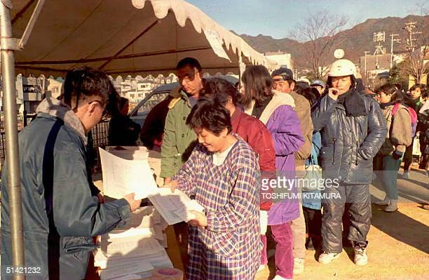 Earthquake victims line up to receive application forms for temporary housing in Kobe 27 January 1995 ten days after the massive earthquake hit Kobe...