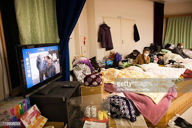 Earthquake victims watch a Television at evacuation center on March 26 2011 in Iwate Prefecture Japan The 90 magnitude strong earthquake struck...