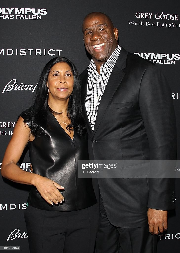 Earvin 'Magic' Johnson and Cookie attend the 'Olympus Has Fallen' Los Angeles Premiere held at ArcLight Cinemas Cinerama Dome on March 18, 2013 in Hollywood, California.