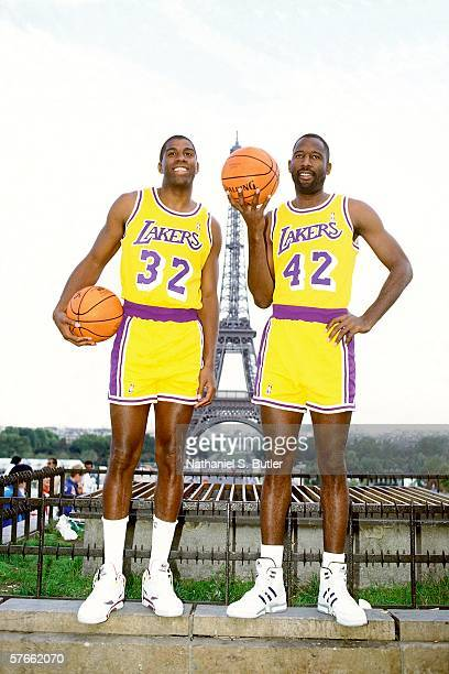 Earvin 'Magic' Johnson and James Worthy of the Los Angeles Lakers pose for a portrait with the Eiffel Tower in the background circa 1991 in Paris...