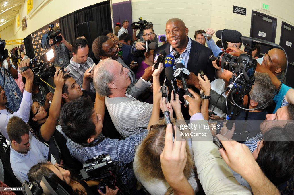 Earvin 'Magic' Johnson answers questions from the media as the Los Angeles Lakers introduce <a gi-track='captionPersonalityLinkClicked' href=/galleries/search?phrase=Byron+Scott+-+Basketball+Coach&family=editorial&specificpeople=209087 ng-click='$event.stopPropagation()'>Byron Scott</a> as their new head coach during a press conference on July 29, 2014 at Toyota Sports Center in El Segundo, California.