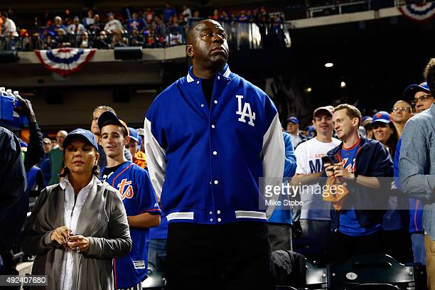 "Earvin ""Magic"" Johnson attends game three of the National League Division Series between the Los Angeles Dodgers and the New York Mets at Citi Field..."