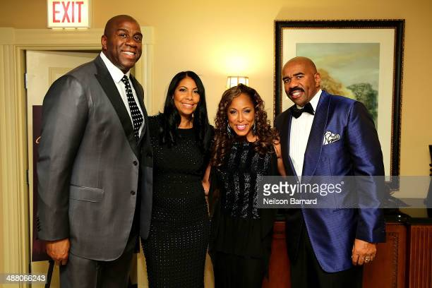 Earvin 'Magic' Johnson his wife Cookie Johnson Marjorie Harvey and Steve Harvey attend the 2014 Steve Marjorie Harvey Foundation Gala presented by...