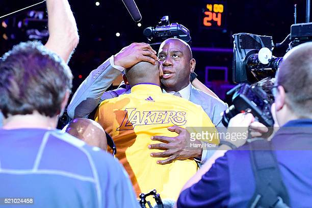 Earvin 'Magic' Johnson hugs Kobe Bryant of the Los Angeles Lakers before the game against the Utah Jazz at Staples Center on April 13 2016 in Los...