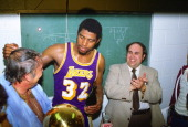 Earvin Magic Johnson of the Los Angeles Lakers celebrates with team owner Jerry Buss after they defeated the Philadelphia 76ers in the 1980 NBA...